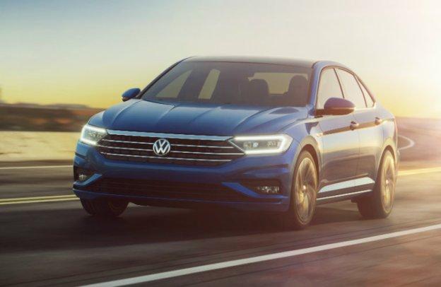 2019 Volkswagen Jetta emerges from a glow of sunshine.
