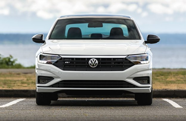 Head-on view of a white 2020 Volkswagen Jetta by the lakeshore.