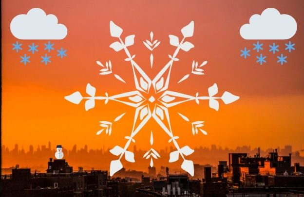 Giant white snow flake, along with sporadic other snows, dangle over an industrial city