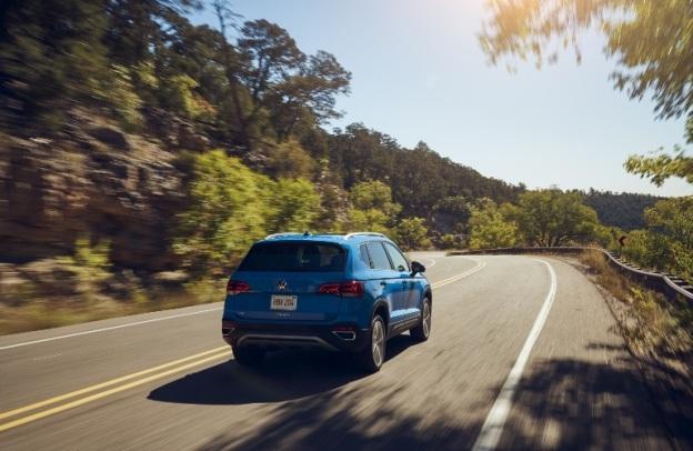 2022 Volkswagen Taos zips away down a highway