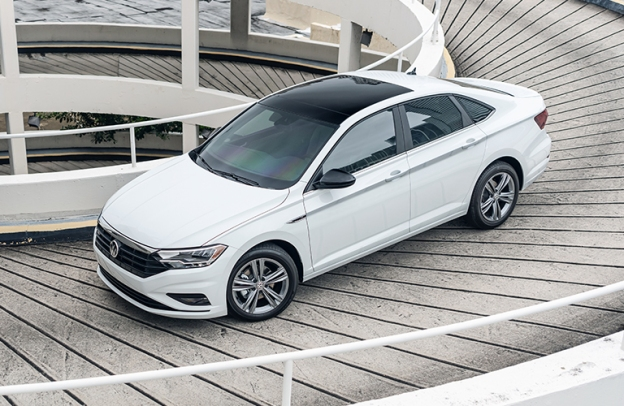 White 2021 Volkswagen Jetta drives down a spiral ramp