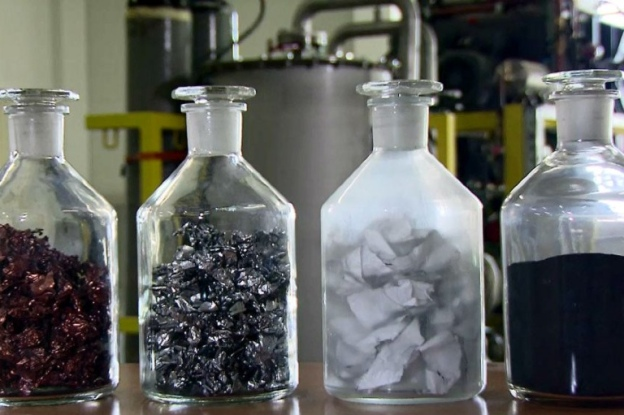 Several jars hold precious minerals from recycled batteries