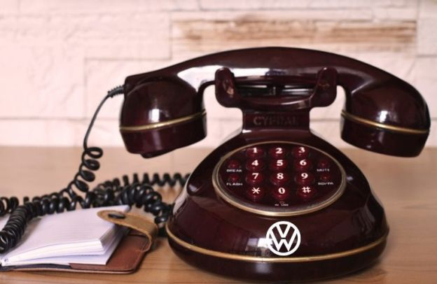 Old-fashioned telephone adorned with the Volkswagen logo
